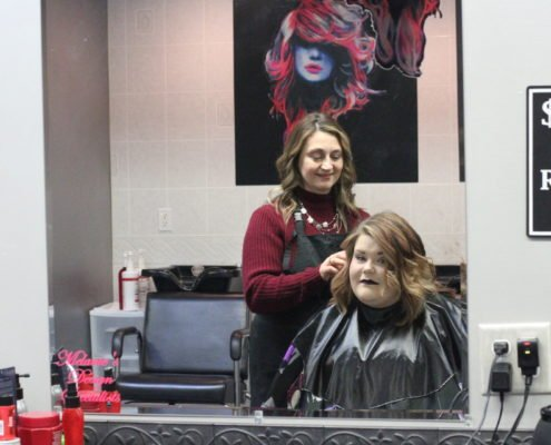 hair styling on client | beauty academy in Marietta, OH | Preston's Beauty Academy