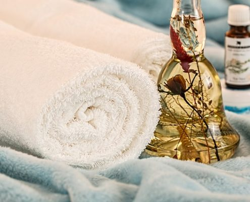 towels and massage oil | beauty academy in Marietta, OH | Preston's Beauty Academy