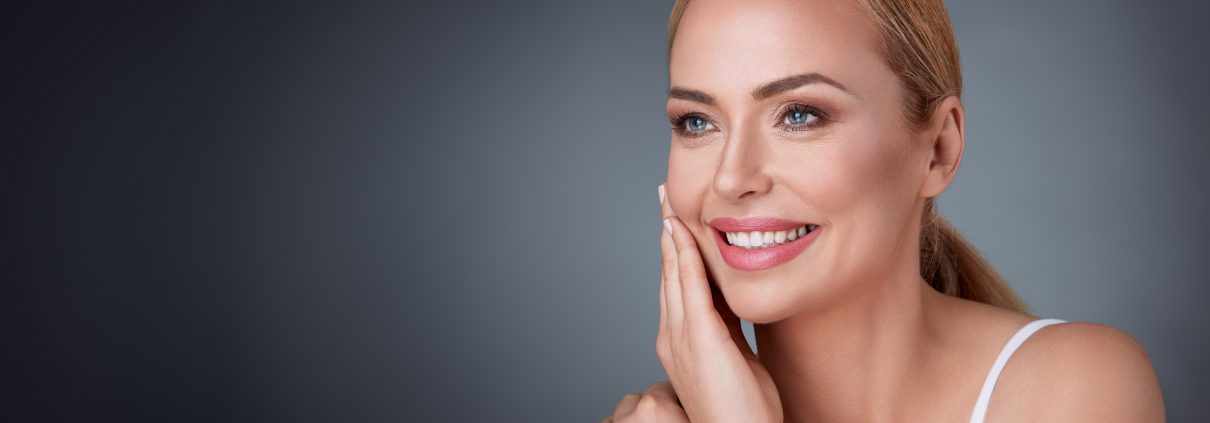 smiling middle aged woman   Prestons Beauty Academy
