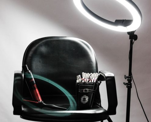stylist chair and light - Preston's Beauty Academy