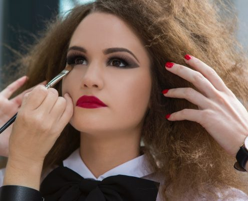 model getting makeup done   Prestons Beauty Academy